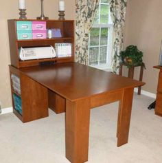 table with lots of storage and a built-in power strip on the bottom of hutch!