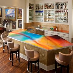 Perfect+for+entertaining,+this+custom+bar+is+conveniently+located+next+to+the+billiard's+room.+Outfitted+with+a+colorful+countertop,+gold+backsplash+and+plenty+of+storage+space,+this+is+one+place+your+guests+will+never+want+to+leave.