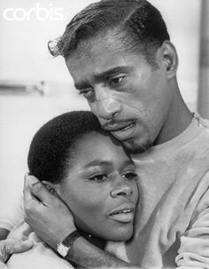 "1/15/1966 - Sammy Davis, Jr. clutches co-star Cicely Tyson towards him during a tender scene from the film ""A Man Named Adam."" Movie Still."