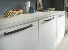 The Contrast Of These Vintage Nickel Pulls On White Cabinets Looks Great