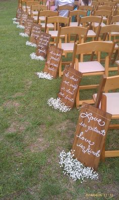 Hand painted aisle signs with baby's breath bunches.