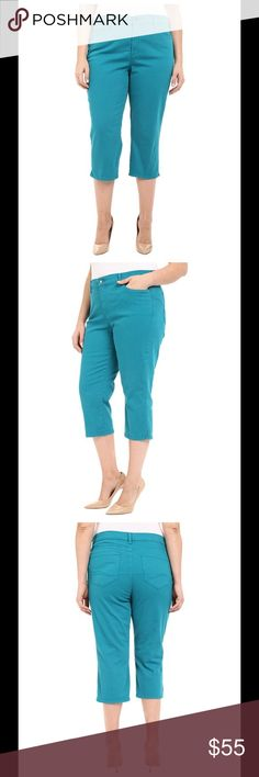 NYDJ Ariel Crop capris Side Slit Turquoise Stretch twill fabric is soft, lightweight and easy on your curves. High rise hits just at the belly button for a sleek look. Revolutionary crisscross front panel slims the tummy for a trim silhouette. Zipper fly and button closure. 98% cotton, 2% elastane. Machine wash cold,line dry. Imported. Measurements: Waist Measurement: 38 in Outseam: 32 in Inseam: 21 in Front Rise: 12 in Back Rise: 18 in Leg Opening: 16 in Product measurements were taken…
