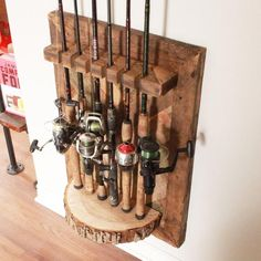 Display your fishing rods in style, so theyre always at the ready for the next big catch. This barn wood herringbone and maple fishing rod rack will hold six of your prized fishing rods. The maple half-round is the perfect, rustic base, with a stunning he Fishing Pole Storage, Fishing Pole Holder, Pole Holders, Fishing Rods, Bass Fishing, Crappie Fishing, Fishing Bait, Saltwater Fishing, Fishing Tackle