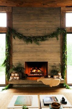 Rustic and simple holiday decorations -- juniper garland above the fireplace, cozy sheepskin draped on the fireside bench, and branches and boughs of juniper and pine in arrangements by the fire. Cabin chic but also equally stunning in an urban apartment.