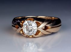 1 Carat Old Mine Cut Diamond Antique Men's Ring circa 1890 The 14K gold strapwork ring is prong-set with a sparkling bright white antique cushion cut diamo
