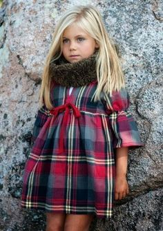 Tartan. Wish she wore leggings, the outfit would look extra cute.