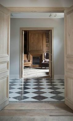 Black and white checkered floors. House Design, House, Interior, Home, Interior Architecture, Beautiful Interiors, Wood Fireplace Surrounds, Flooring, Checkered Floors