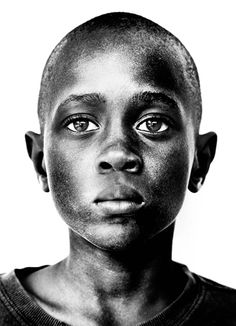 boy who has seen too much, kid, child, boy, strong, sadness, solitude, thoughtfull, moody, portrait, black, photo b/w.