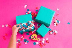 Use double-sided tape and tissue confetti to decorate your presents.