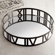 When outfitted with martinis or a glass of wine, our clock tray makes a modern style statement for happy hours at home. With Roman numerals of black iron circling the tray's mirrored surface, this would make an awesome wedding or housewarming gift. Another way to put the tray to good use? As an impressive display space that dresses up your coffee table while corralling tchotchkes or remote controls.