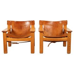 Pair of Leather and Wood Spanish Bernt Petersen Armchairs