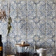Hottest look in handmade Talavera 8x8 tile. Looks stunning on kitchen backsplash or bathroom mural picture framed with a classic 3x6 alabaster glass white subway tile.