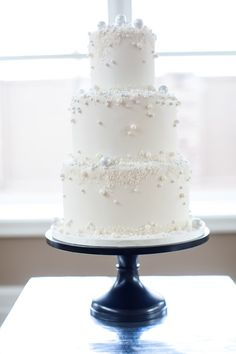 all white wedding cake, photo by Alexis June Weddings http://ruffledblog.com/spring-neon-wedding-inspiration #weddingcake #cakes