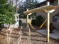 hammock stand for the back yard, but less 'heavy' looking on top.