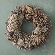 """A sparkling adornment for the cooler seasons, this festive wreath pairs natural pine cones with bright glitter.- Pine cones, glitter- Indoor use only- Avoid moisture and direct sunlight- Imported3.75""""D, 12"""" diameter"""