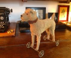 A Steiff Terrier Dog pull toy...Mohair, with iron wheels. c1920's. Marked Steiff.