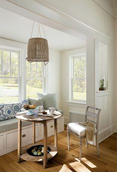 Beach style corner breakfast zone with banquette that also offers hidden storage space