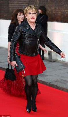 Coordinating with the carpet: Comedian Eddie Izzard went for a red skirt and matching lips...