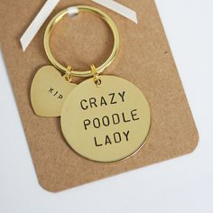 Crazy Poodle Lady Hand stamped Keyring, Personalised with dogs name(s) by TheJanuaryRose on Etsy https://www.etsy.com/listing/453787588/crazy-poodle-lady-hand-stamped-keyring
