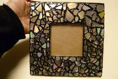 Out-of-date electronics like CDs and DVDs can often be found for mere pennies at thrift stores. But what should you do with that old disc after you've copied your favorite songs onto a laptop?     This clever mosaic photo frame from Make It Easy Crafts blogger Crystal Donnelly proves there's always a use for an old CD.