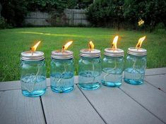 DIY oil lamps for the porch/yard; use citronella oil to mosquitoes away. DIY oil lamps for the porch/yard; use citronella oil to mosquitoes away. Citronella Torches, Citronella Candles, Jar Candles, Tiki Torches, Candels, Citronella Oil Uses, Candle Wicks, Mason Jars, Mason Jar Crafts