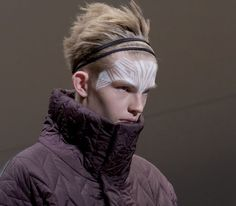 Sharpie markers used to create forehead tattoos on male models for the Qasimi Homme collection