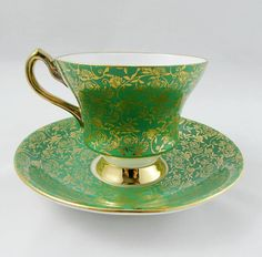 Made by Windsor, tea cup and saucer are green with gold detailing. Large flower on the inside rim of the tea cup and centre of the saucer. Gold trimming, and gold handle and foot on the tea cup. Excellent condition (see photos). Markings read: Bone China Windsor Made in England