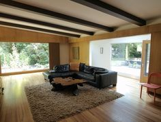 retro-cool living room by John Prindle - cedar wall panelling are making a come back