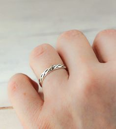 Braided Sterling Silver Band | This sterling silver band features an intricate braided design... | Rings