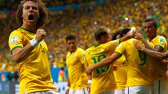 David Luiz of Brazil (L) celebrates his team's third goal, scored by Fred