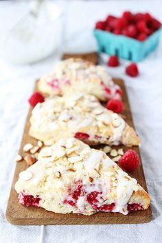 Raspberry Almond Scones. @Maria (Two Peas and Their Pod) has the perfect Sunday morning treat for your family.