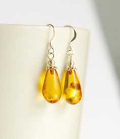 Sterling silver earrings with natural Baltic amber by byVellamo, $21.00