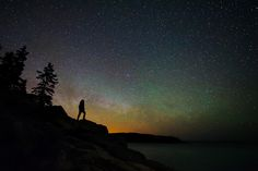 Acadia skyscape by Guillaume Poulin. The rising Milky way and some green airglow provide a nice backdrop for a stargazer's silhouette at Acadia National Park, Maine.