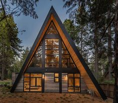 This innovative, rustic contemporary A-frame cabin designed by Todd Gordon Mather Architect is located in Lake Tahoe, California. A Frame House Plans, A Frame Cabin, Tiny House Plans, Barn House Plans, Cabin Design, Roof Design, House Design, Design Design, Lake Cabins