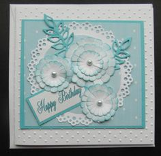 Hand made card - Flowers, Doilly and embossing done on Cuttlebug; flowers tinted with blue distressed ink