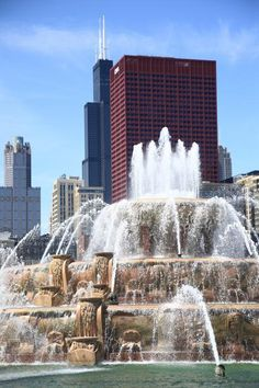 Chicago skyscrapers and famous Buckingham Fountain in Grant Park. Mostly the fountain in this one, with just enough of the Chicago landmarks to make it recognizable.                                                                                                                                                      More
