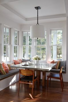 Dining table with fixed benches and chairs. Project by Breese Architects and Interiors Studio Martha's Vineyard