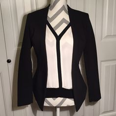 100% Silk Off-white and Black Top from WHBM Worn once and dry cleaned. Perfect condition. Beautiful top that is 100% silk. Banded cotton waistband at hem. Light and airy. Pair with a blazer for a great work look! White House Black Market Tops Blouses