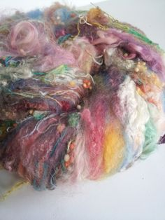 Jam packed with nothing but fleece, locks, and other fiber bits, my Betty Batts are carded on my super coarse vintage Fricke drumcarder for a just barely blended, highly textural result. Stash em', spin em', or felt them! Snag em' fast because these are a Bricolage Studios favorite! All Betty Batts are 2 oz. Contents: merino, BL x, BFL x, suri alpaca, upholstery salvage, wool neps, silk noilsPlease be advised that all fleece and locks in these batts are hand picked...
