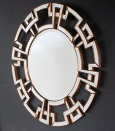 "Greek key design modern mirror with beveled glass. Dimensions: Dia 47 1/4"" x D 1"" Item No: PE002"