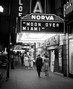 July 22, 1941 night photograph from  Norfolk Public Library's Sargeant Memorial Collection featuring The NorVA on Granby Street in Norfolk, VA. Other businesses identified include: Loew's State Theatre, Bamboo Inn Restaurant and Wilson Shoes. #NorfolkVA #history
