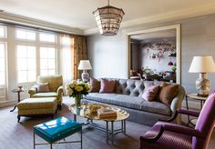 Living room in soft colors. Especially love the tufted sofa (by Caitlin Moran Interior Design)