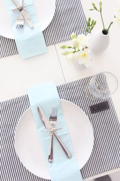 The cool breeze in a summer table of white with black stripe for a place setting that makes everyone comfortable..