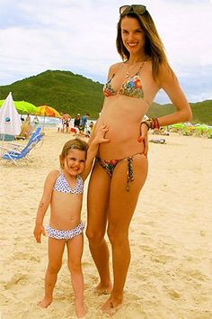 Pin for Later: 41 Celebrities Who Rocked the Bikini While Pregnant  Alessandra Ambrosio shared a picture of herself pregnant and in a bikini on the beach with her daughter Anja. Source: Twitter user angelalessandra