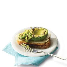 Grilled Avocado on Toast salt, olive oil, avocado, lime juice, parmesan cheese and bread