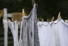 old fashioned pins - Mom hung her wash outside in the summer and in the basement in the winter.  I remember the crunch sound as the clothes pins were pushed onto the clothing item and the cotton clothesline.