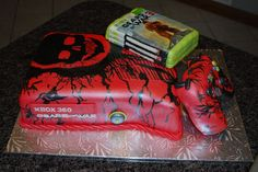 Gears of War Groom's Cake.  Cake covered in fondant with hand painted designs to look like this special edition XBOX console.