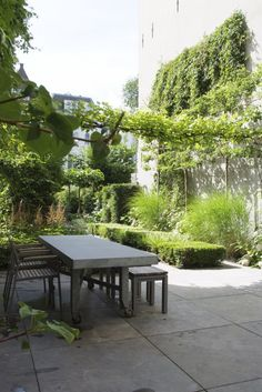 tuinontwerp Robert Broekema, tuinaanleg door Van Raaijen Hoveniers - grachtentuin Amsterdam