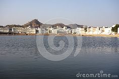 Photo about A view of the city of ancient Pushkar Rajasthan with its ancient lake in front. Image of sins, particular, oasis - 70658159 India, Celestial, City, Outdoor, Image, Outdoors, Delhi India, Outdoor Games, City Drawing