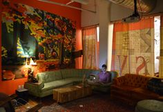 Etsy - Behind the curtain is a comfy spot for employees to work or relax.